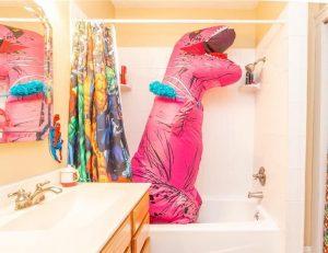 Opblaasbaar T-rex kostuum dino pak roze Jurassic World™ volwassenen